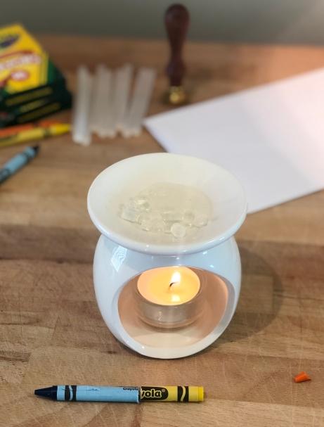 After 3 or 4 minutes melting glue sticks on candle warmer